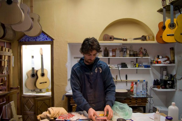 Guitar makers in his shop in Poble Espanyol.