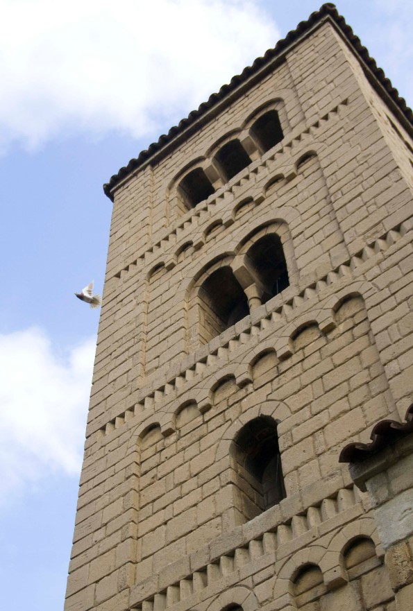 A bird flying out of a tower in Poble Espanyol, a village which represents Spain on the whole.
